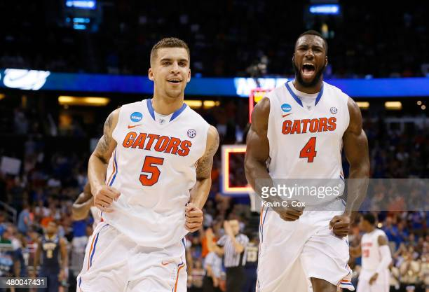 Scottie Wilbekin and Patric Young of the Florida Gators celebrate after Wilbekin makes a threepointer to end the first half against the Pittsburgh...
