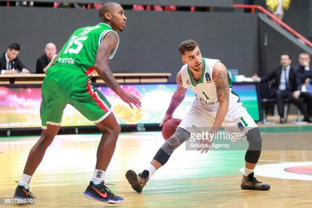 Scottie Wilbekin of Darussafaka Dogus in action against Jamar Smith of UNICS Kazan during the EuroCup basketball match between UNICS Kazan and...
