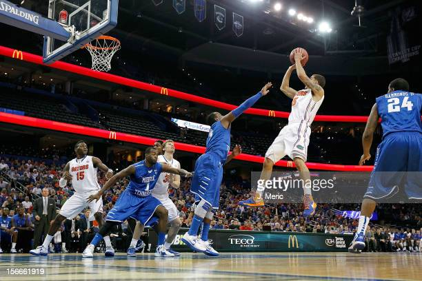 Scottie Wilbekin of the Florida Gators shoots against the Middle Tennessee Blue Raiders during the game at the Tampa Bay Times Forum on November 18...