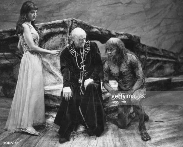 Scottish actor Alastair Sim as Prospero with Eileen Atkins as Miranda and George Selway as Caliban during a rehearsal for Shakespeare's 'The Tempest'...