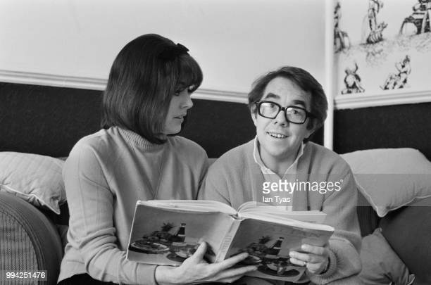 Scottish actor and comedian Ronnie Corbett and his wife, actress Anne Hart study a book on Italian cookery, January 1969.