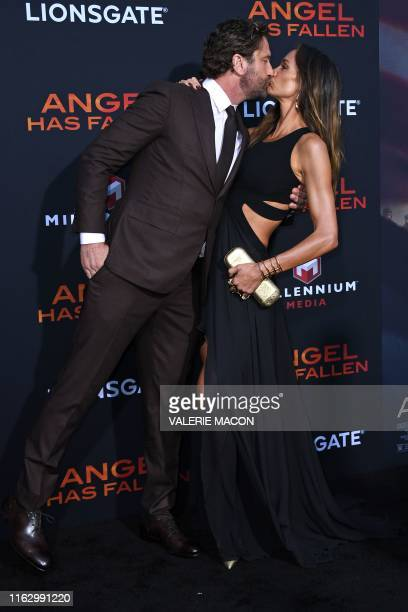 Scottish actor Gerard Butler and girlfriend US actress Morgan Brown kiss as they arrive for the Los Angeles premiere of Angel Has Fallen at the...
