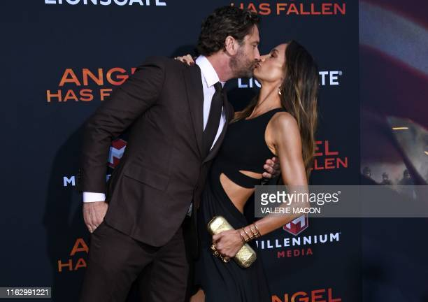 """Scottish actor Gerard Butler and girlfriend US actress Morgan Brown kiss as they arrive for the Los Angeles premiere of """"Angel Has Fallen"""" at the..."""
