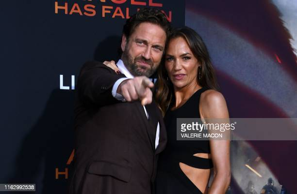 Scottish actor Gerard Butler and girlfriend US actress Morgan Brown arrive for the Los Angeles premiere of Angel Has Fallen at the Regency Village...