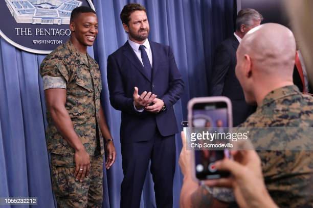 Scottish Actor Gerard Butler poses for photographs with members of the US military following a news briefing about his new submarine action film...