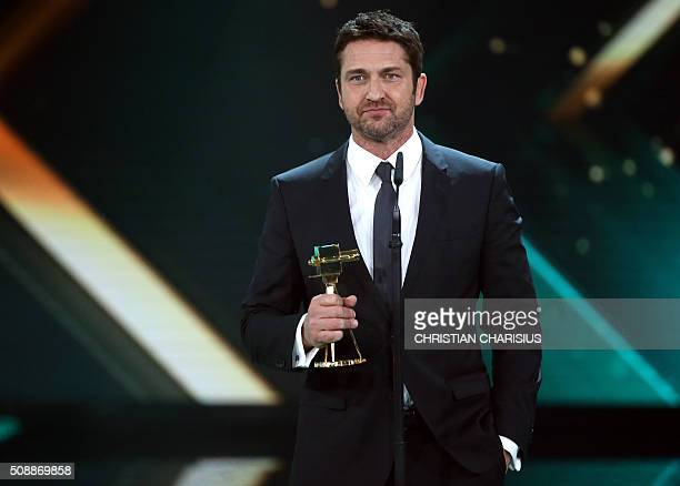 Scottish actor Gerard Butler receives the Golden Camera award for Best International actor in Hamburg northern Germany on February 6 2016 / AFP /...