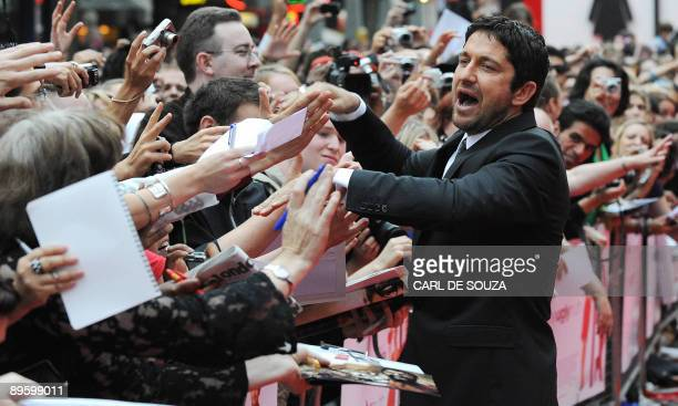 Scottish actor Gerard Butler shakes hands with fans as he arrives for the European premiere of the film The Ugly Truth at Leicester Square London on...