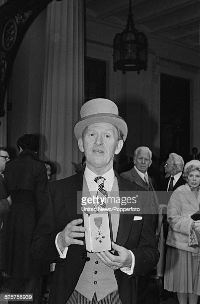 Scottish actor Gordon Jackson pictured holding his OBE at an investiture ceremony at Buckingham Palace in London on 13th March 1979