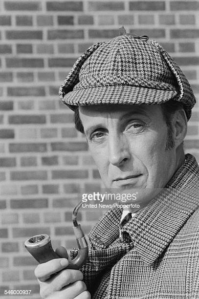 Scottish actor Ian Richardson pictured dressed in character as Sherlock Holmes during filming of the television movie 'The Sign of Four' at...