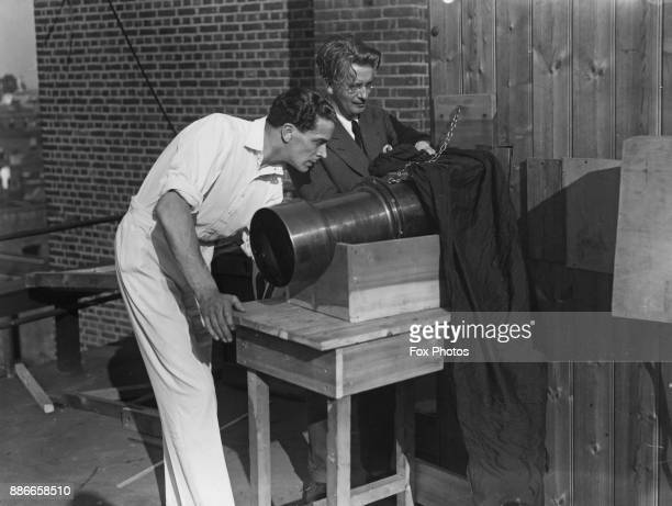 Scottish actor Jack Buchanan and inventor John Logie Baird using broadcasting apparatus on the roof of the television company 1928