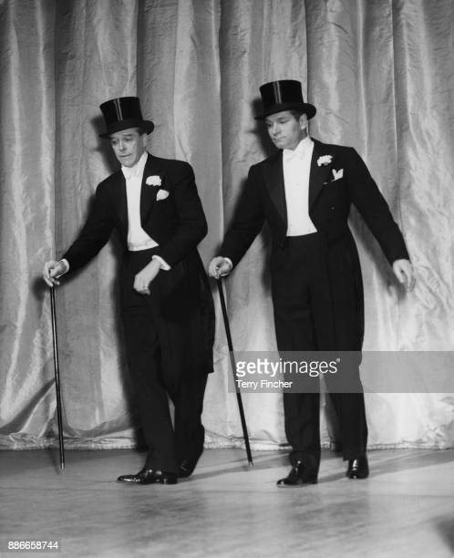 Scottish actor Jack Buchanan tap dancing with Sir Laurence Olivier during rehearsals for the charity show 'Midnight Cavalcade' at the London...