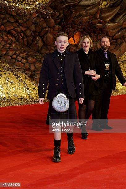 """Scottish actor John Bell and parents attend the """"The Hobbit: The Desolation of Smaug"""" European Premiere at Cinestar on December 9, 2013 in Berlin,..."""