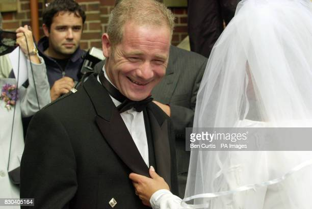 Scottish actor Peter Mullan talks to bride Gail Healy at her wedding to Scottish Socialist MSP Tommy Sheridan at the Our Lady of Lourdes Church in...