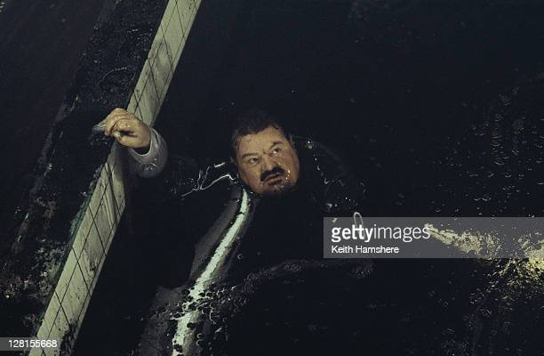 Scottish actor Robbie Coltrane stars as Valentin Dmitrovich Zukovsky in the James Bond film 'The World Is Not Enough' 1999 Here he nearly drowns in...