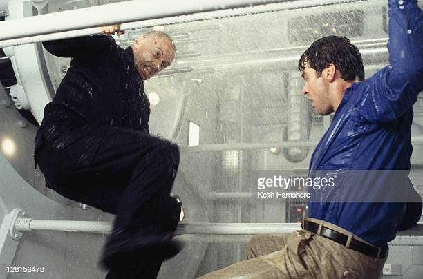 Scottish actor Robert Carlyle as Renard and Irish actor Pierce Brosnan in a submarine fight from the James Bond film 'The World Is Not Enough' 1999