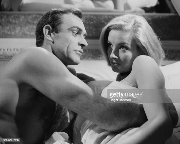 Scottish actor Sean Connery and actress Daniela Bianchi film a bedroom scene for the James Bond film 'From Russia With Love' at Pinewood Studios UK...