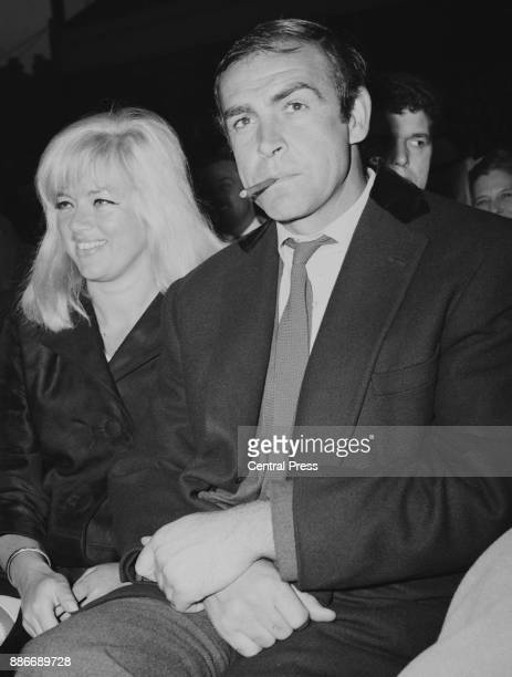 Scottish actor Sean Connery and actress Diana Dors await the Heavyweight Champion of the World fight between Henry Cooper and Muhammad Ali at Arsenal...