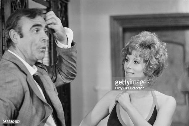 Scottish actor Sean Connery and American actress Jill St John pictured in character as James Bond and Tiffany Case on set during production of the...