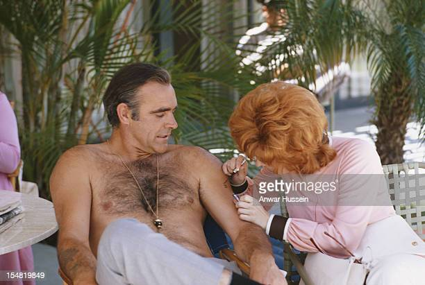 Scottish actor Sean Connery and American actress Jill St John on the set of the James Bond film 'Diamonds Are Forever' USA May 1971