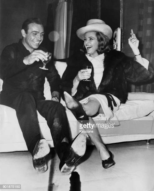 Scottish actor Sean Connery and English actress Honor Blackman enjoy themselves during a break in filming the James Bond movie 'Goldfinger' at...