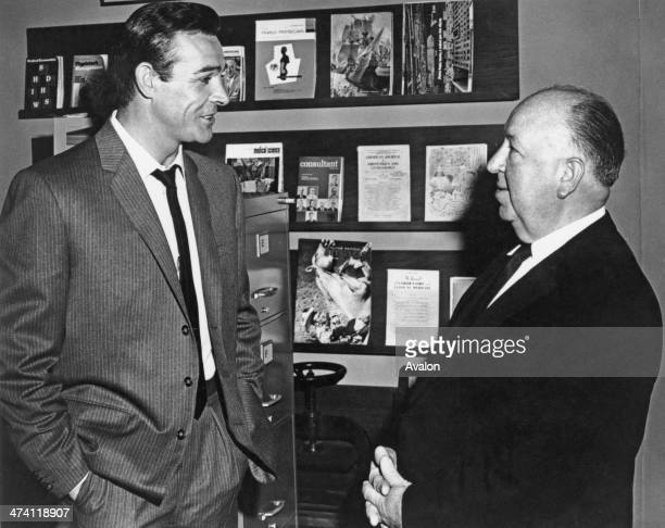 Scottish actor Sean Connery and English director Alfred Hitchcock discussing their thriller 'Marnie' which is in production in Hollywood February 1964