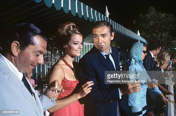 Scottish actor Sean Connery and French actress Claudine Auger smoking smiling in the film Thunderball 1965