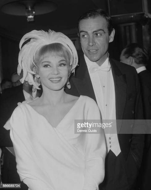 Scottish actor Sean Connery and his wife actress Diane Cilento arrive at the Royal Film Performance of 'Lord Jim' at the Odeon Theatre London 15th...
