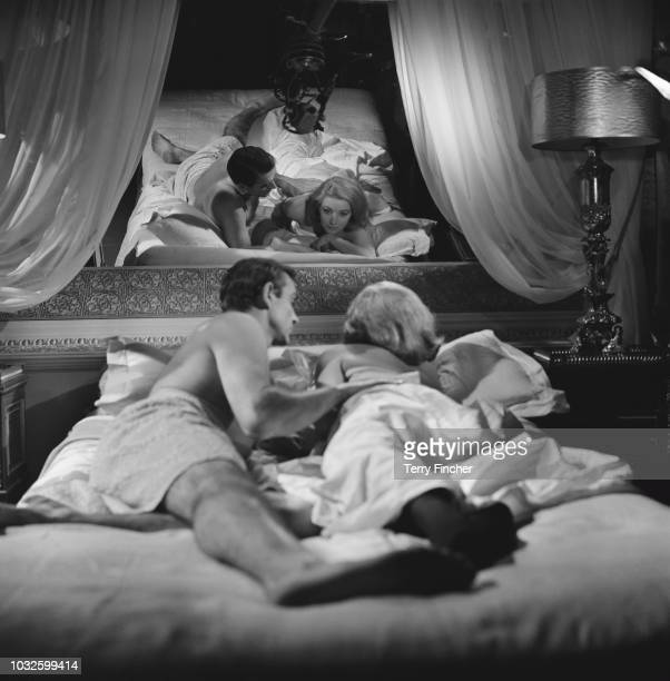 Scottish actor Sean Connery and Italian actress Daniela Bianchi rehearse and film a bedroom scene for the James Bond film 'From Russia With Love' at...