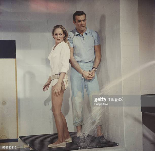 Scottish actor Sean Connery and Swiss born actress Ursula Andress pictured together in character as James Bond and Honey Ryder in a shower scene from...