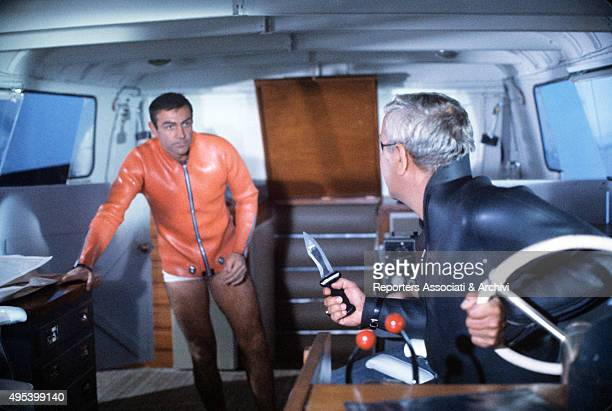Scottish actor Sean Connery arguing with Italian actor Adolfo Celi in the film Thunderball 1965