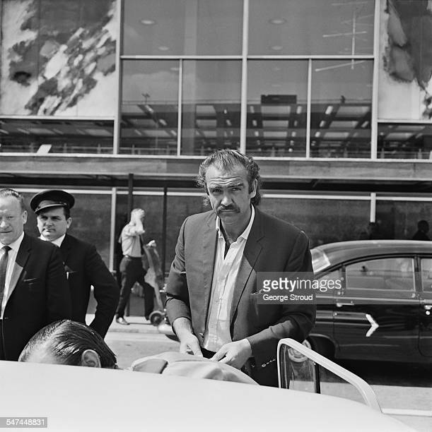Scottish actor Sean Connery arriving at London Airport 30th June 1967