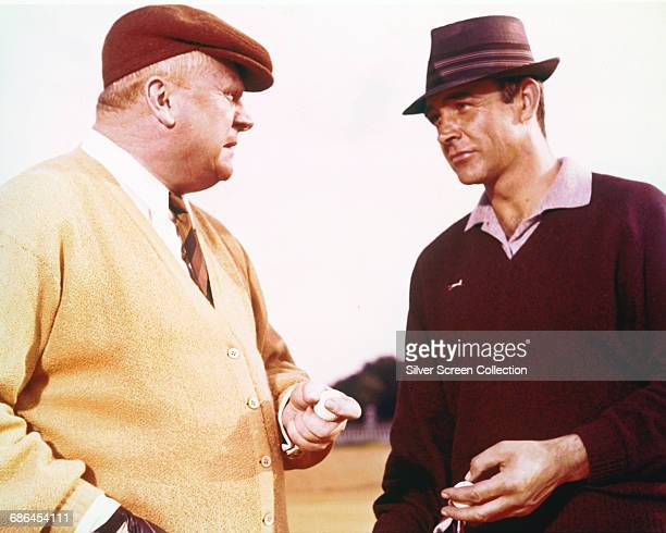 Scottish actor Sean Connery as James Bond and German actor Gert Fröbe as Auric Goldfinger in the film 'Goldfinger' 1964