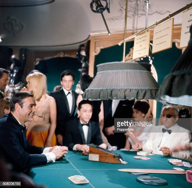 Scottish actor Sean Connery as James Bond and Italian actor Adolfo Celi as eye patch wearing Emilio Largo pictured together in a casino scene from...