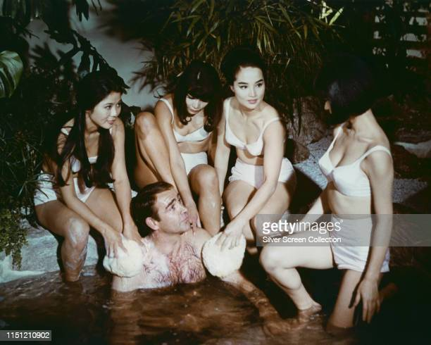 Scottish actor Sean Connery as James Bond enjoys a Japanese onsen or bath in the film 'You Only Live Twice' 1967