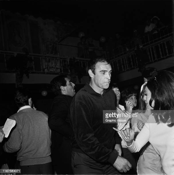 Scottish actor Sean Connery dancing at Whisky A Go Go, a nightclub in West Hollywood, California, 1965.