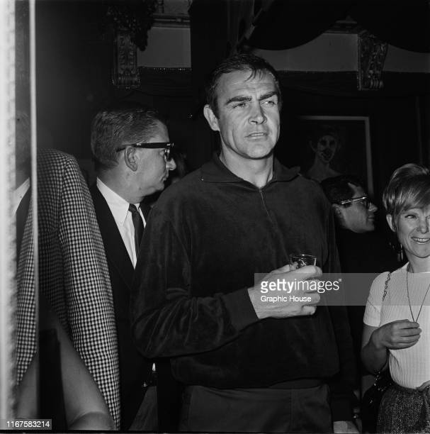 Scottish actor Sean Connery drinking at Whisky A Go Go, a nightclub in West Hollywood, California, 1965.