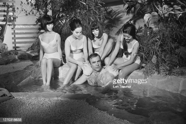 Scottish actor Sean Connery filming a bath scene for the James Bond film 'You Only Live Twice' at Pinewood Studios UK September 1966 His female...