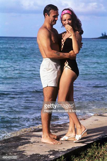 Scottish actor Sean Connery hugging French actress Claudine Auger in the film Thunderball 1965