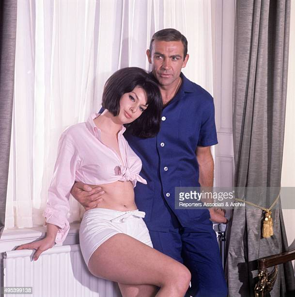 Scottish actor Sean Connery keeping his hand on French actress Claudine Auger 's hip in the film Thunderball 1965