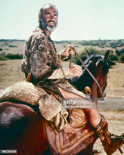 Scottish actor Sean Connery looks over his shoulder astride a horse in a scene from 'Robin and Marian' Spain 1976