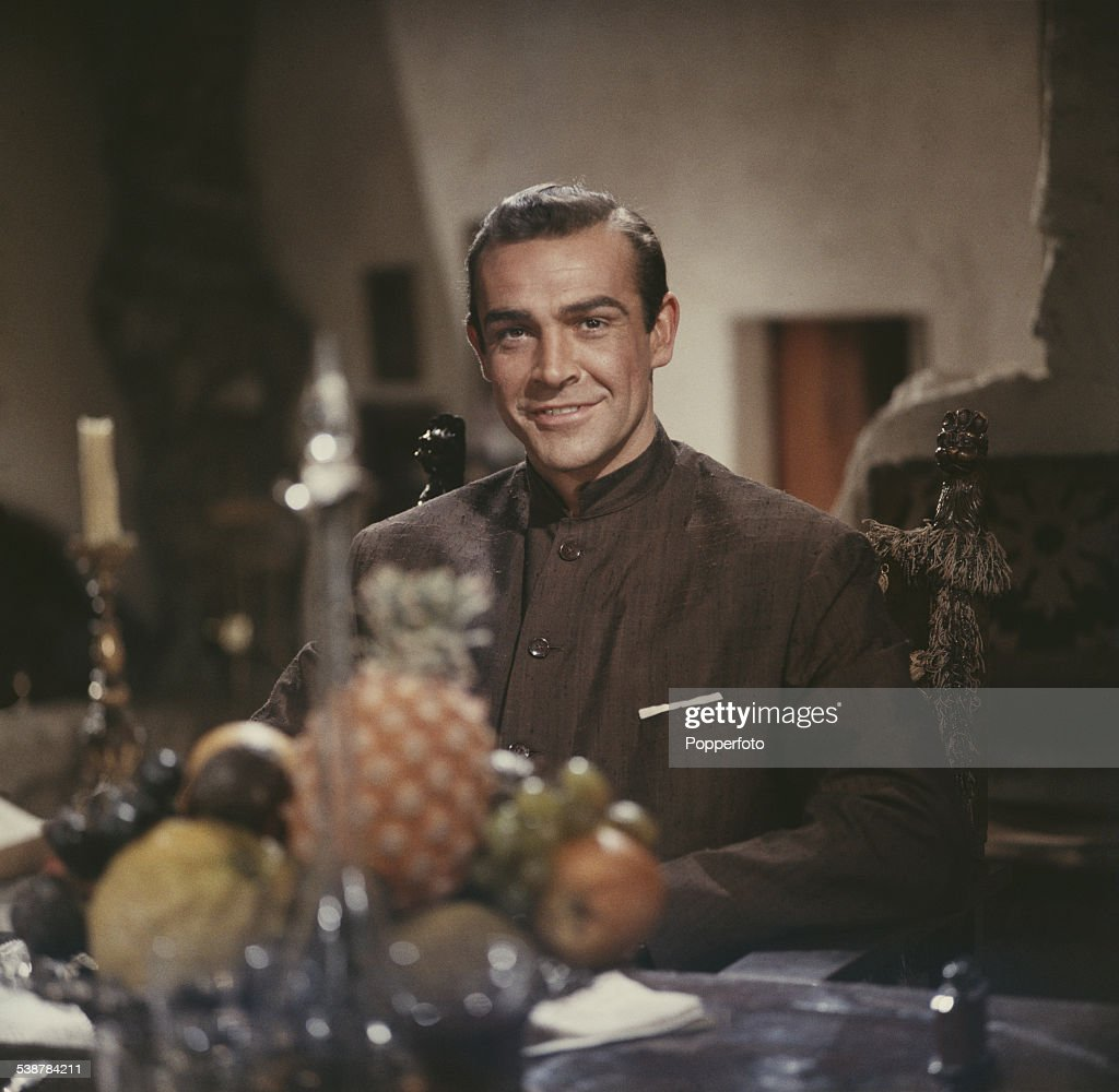 Scottish actor Sean Connery, pictured wearing a Nehru jacket, in character as James Bond in a scene from the James Bond film 'Dr. No' at Pinewood Studios in England in 1962. (Photo by Popperfoto/Getty Im