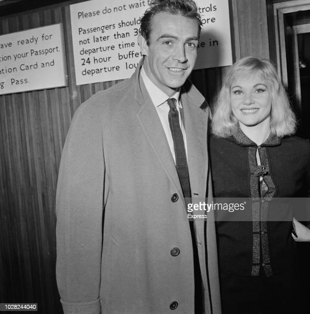 Scottish actor Sean Connery pictured with his wife Australian actress Diane Cilento at London airport on 17th August 1963 Sean Connery is currently...