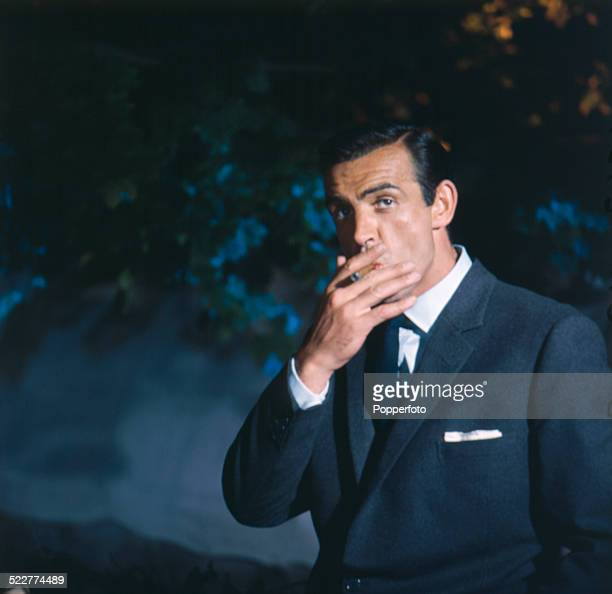 Scottish actor Sean Connery posed smoking a cigar in character as James Bond on the set of the film 'From Russia With Love' at Pinewood Studios in...
