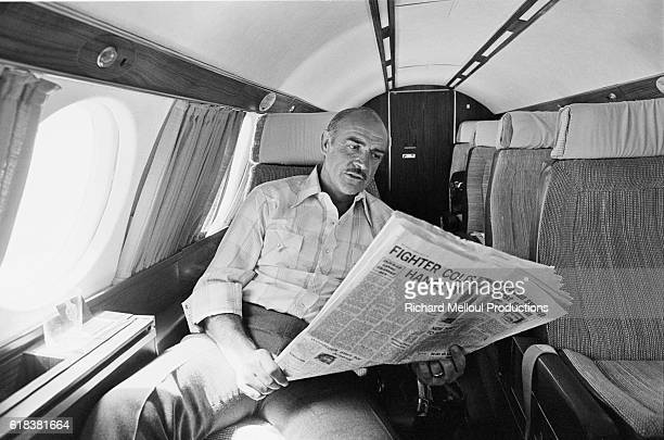Scottish actor Sean Connery reads a newspaper aboard a private airplane on his way to the Cannes Film Festival He completed two films this year Time...