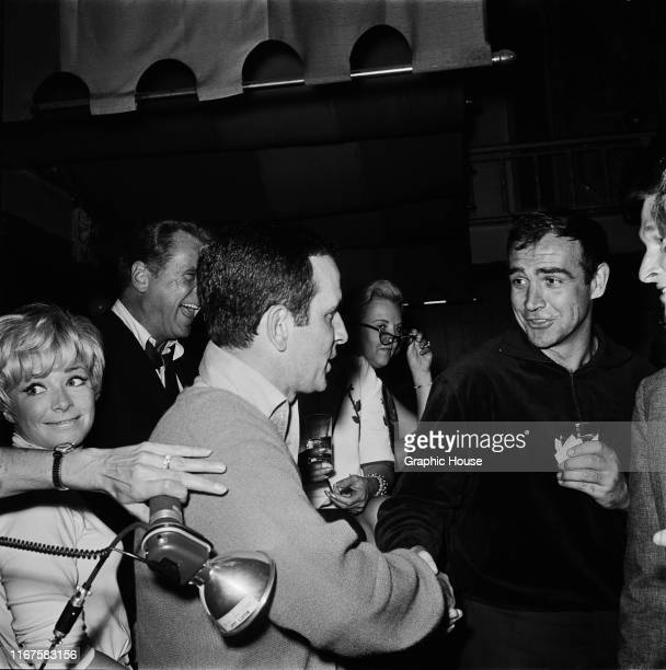 Scottish actor Sean Connery shakes hands with Don Adams at Whisky A Go Go, a nightclub in West Hollywood, California, 1965.