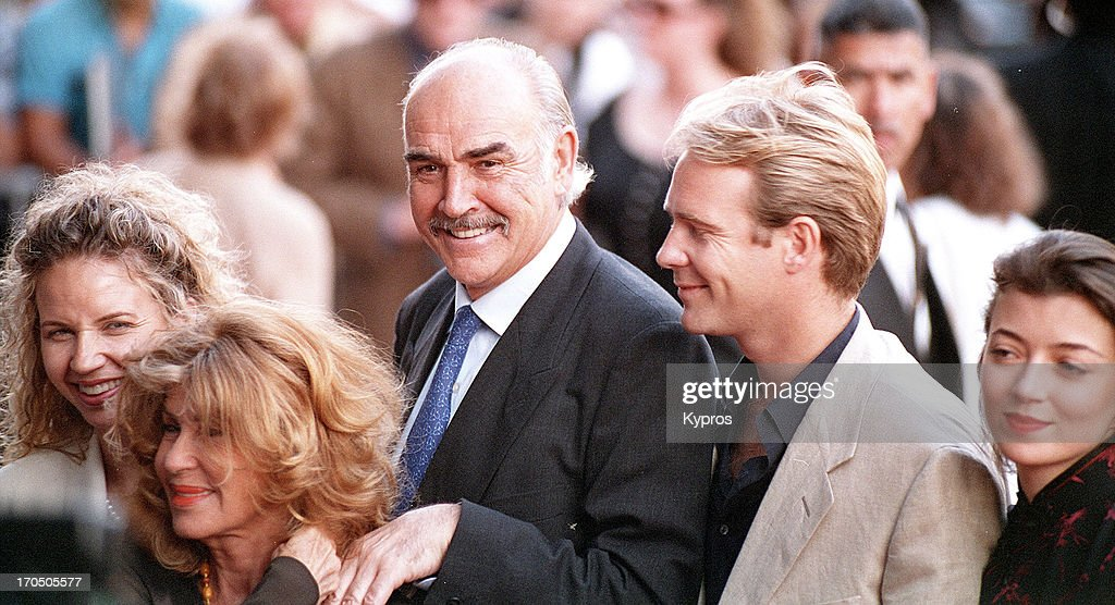 Scottish actor Sean Connery with his wife Micheline, his son Jason Connery and actress Mia Sara (right), circa 1995.