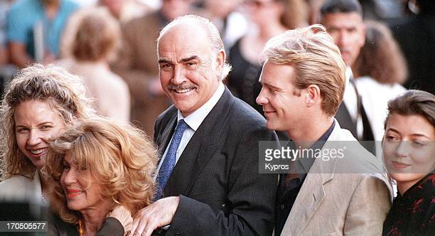 Scottish actor Sean Connery with his wife Micheline, his son Jason Connery and actress Mia Sara , circa 1995.