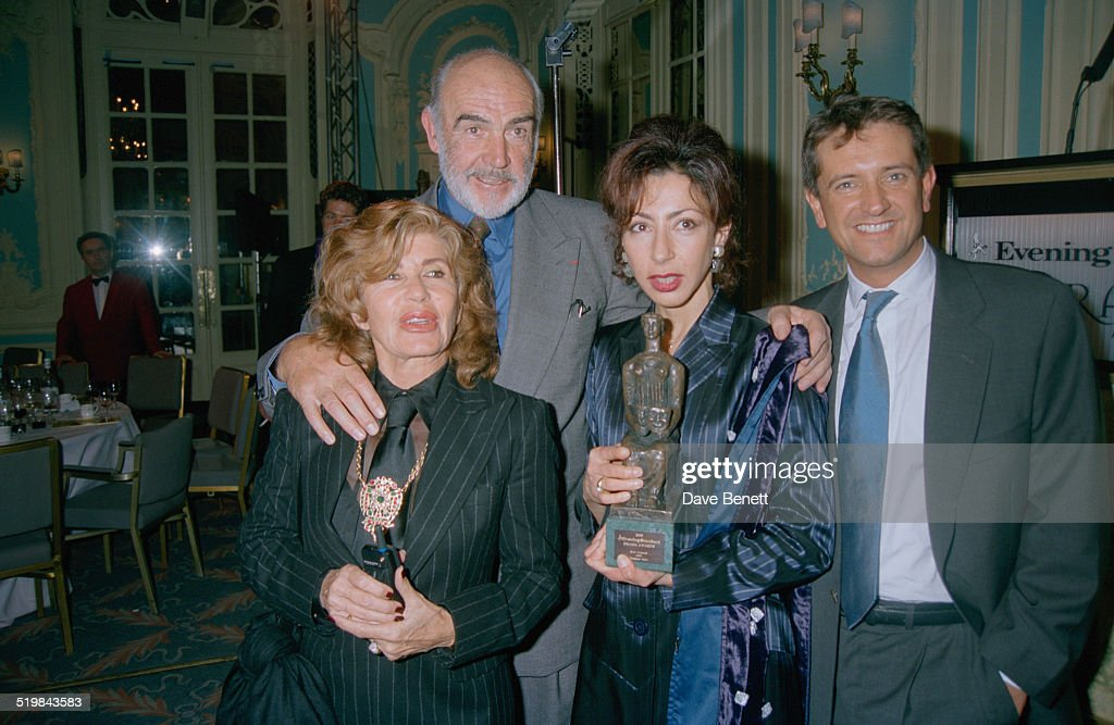 Scottish actor Sean Connery (left) with his wife, Micheline Roquebrune (far left) and French writer Yasmina Reza, at the Evening Standard Theatre Awards, held at the Savoy Hotel, London, 29th November 1996. Reza is holding her award for Best Comedy for 'Art'.