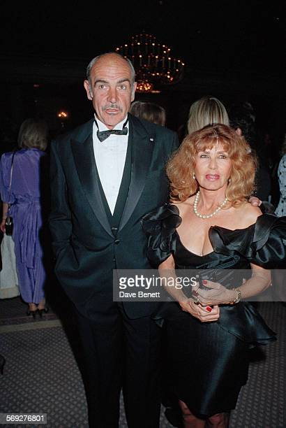 Scottish actor Sean Connery with his wife Micheline Roquebrune attend the 1990 BAFTA Film and Television Awards in March 1990 in London, England.