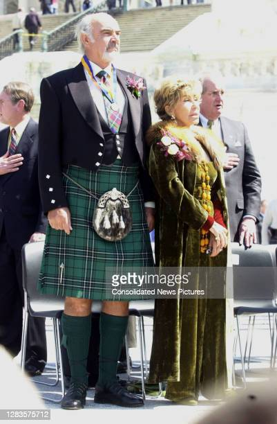 Scottish actor Sir Sean Connery and Lady Micheline Connery stand with others as they listen to the United States and Scottish National Anthems...